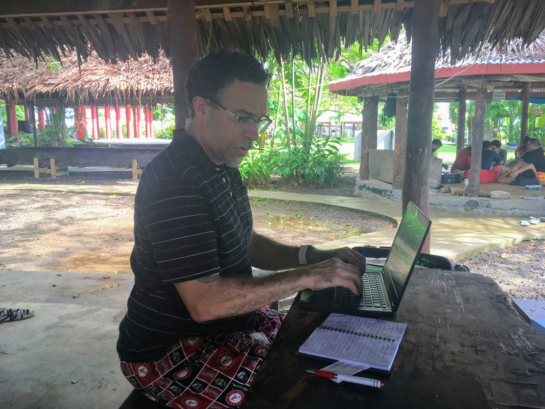 Dr. Lynn working typing field notes in Samoa